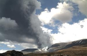 In this photo released by the Institute of Geological and Nuclear Sciences (GNS) smoke billowing out of Te Maari crater on Mount Tongariro, New Zealand after a brief eruption Wednesday, Nov. 21, 2012.