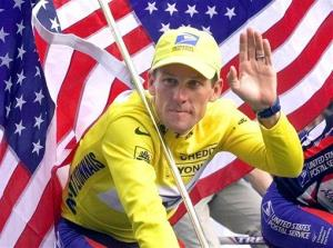 This July 23, 2000 file photo shows Tour de France winner Lance Armstrong riding down the Champs Elysees with an American flag in Paris, France.
