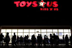 In this Thursday, Nov. 25, 2010, file photo, people line up outside Toys R Us as Black Friday sales begin, in Royal Palm Beach, Fla.