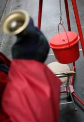 In this Dec. 17, 2008, file photo, a bell ringer for the Salvation Army solicits donations on Fifth Avenue in New York.