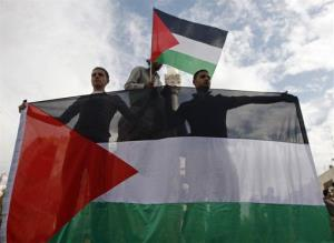 Palestinians celebrate what they call a victory over Israel, in the West Bank city of Ramallah, Thursday, Nov. 22, 2012.