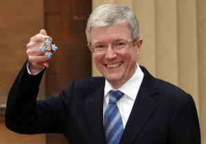 In this file photo dated May 24, 2006, Tony Hall receives a CBE, an official British honor.