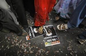 Activists of India's main opposition Bharatiya Janata Party stamp on portraits of Mohammed Ajmal Kasab to celebrate the news of his execution, in Mumbai, Nov. 21, 2012.