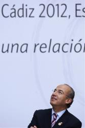 Mexico's President Felipe Calderon waits for the arrival of the rest of leaders for the official photo at the XXII Iberoamerican summit in the southern Spanish city of Cadiz, Saturday, Nov. 17, 2012.