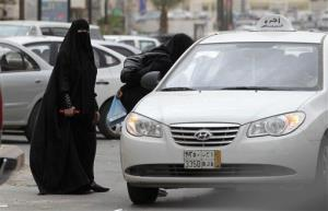 In this Tuesday, May 24, 2011 file photo, Saudi women board a taxi in Riyadh, Saudi Arabia.