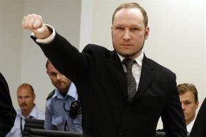 This Aug. 24, 2012 file photo shows mass murderer Anders Behring Breivik making a salute after his arrival at the court room in Oslo.