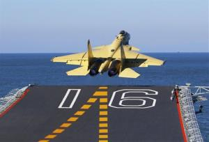 In this undated photo released by China's Xinhua News Agency, made available on Sunday, Nov. 25, 2012, a carrier-borne J-15 fighter jet takes off from China's first aircraft carrier, the Liaoning.