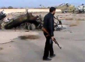 Syrian rebels capture a helicopter air base near Damascus yesterday.