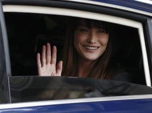 In this May 15, 2012 file photo, Carla Bruni waves from a car as she leaves the Elysee Palace after the presidential handover ceremony.