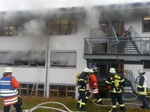 In this image taken from video firefighters try to extinguish flames in a workshop for disabled people in Titisee-Neustadt, southwestern Germany, Monday, Nov. 26, 2012.