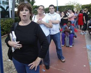"Diana Camacho, left, chants ""we want to vote,"" after Miami-Dade County closed its doors to voters who waited in long lines for an absentee ballot in Doral, Fla., Sunday, Nov. 4, 2012."