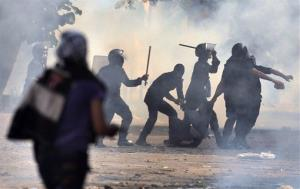 Egyptian security forces arrest a protester during clashes near Tahrir square in Cairo on Tuesday, Nov. 27, 2012.