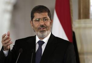 Egyptian President Mohammed Morsi speaks to reporters in July.