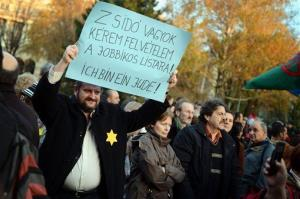 A demonstrator holds a placard while protesting Marton Gyongyosi's speech in Budapest, Hungary, Tuesday, Nov., 27, 2012. The banner reads: I am a Jew. Please, include my name on the Jobbik-list.