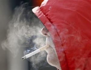A smoker puffs away in this file photo.