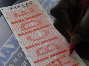 A customer fills in his numbers on a Powerball ticket.