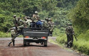 Congolese  M23 rebel fighters dismount as they look for FDLR returning from an incursion into Rwanda Near Kibumba, north of Goma Tuesday Nov. 27, 2012.