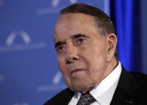 In this March 21, 2012, photo, former Senate Majority Leader Bob Dole looks to the stage during an event honoring Dole and Howard Baker at Mellon Auditorium in Washington.