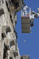 Technicians drop a stone from the top of Rome's ancient Colosseum to evaluate possible risks to visitors, Wednesday, July 18, 2012.  Colosseum director Rossella Rea said the test are being done to evaluate the eventual need of new safety measures in case of an accidental fall of rocks from the...