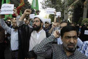 Iranian protestors chant slogans during a demonstration against a film ridiculing Islam's Prophet Muhammad, in front of Swiss Embassy in Tehran