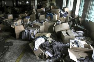 Boxes of garments lay near equipment charred in the fire that killed 112 workers Saturday at the Tazreen Fashions Ltd. factory,on the outskirts of Dhaha, Bangladesh, Wednesday, Nov. 28, 2012.