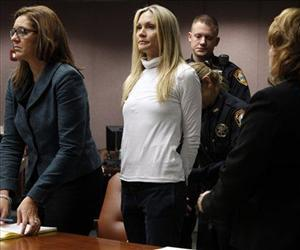 Former Melrose Place actress Amy Locane-Bovenizer, 40 is taken into custody after jurors in Somerville, NJ,  convicted her of vehicular homicide.