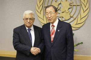 UN Secretary General Ban Ki-moon, right, shakes hands with Palestinian President Mahmoud Abbas at UN headquarters Wednesday, Nov. 28, 2012.