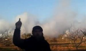 In this image taken from video, a Syrian man speaks as smoke leaps into the air from cluster bombs dropped by an aircraft near a school in Aleppo, Syria, Wednesday, Nov. 28, 2012.