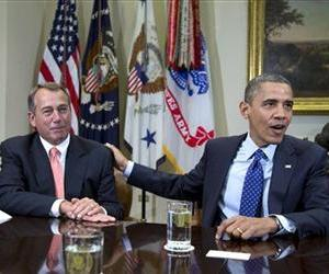 In this Nov. 16, 2012, file photo, President Barack Obama acknowledges House Speaker John Boehner of Ohio while speaking to reporters in the Roosevelt Room of the White House.
