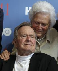 Former President George HW Bush, and his wife Barbara, arrive for the premiere of HBO's new documentary on his life in Kennebunkport, Maine, Tuesday, June 12, 2012.