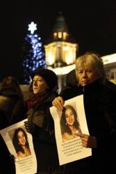 Women hold pictures of Savita during a candlelit vigil outside Belfast City Hall, Northern Ireland, Thursday, Nov. 15, 2012.