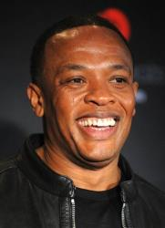 In this Sept. 30, 2009 file photo, Dr. Dre poses for pictures at a press conference announcing, Heartbeats by Lady Gaga, the latest addition to the Beats by Dr. Dre family of headphones.