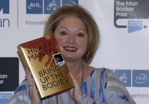 Hilary Mantel, winner of the Man Booker Prize for Fiction, poses for the photographers with a copy of her book 'Bring up the Bodies', in October.