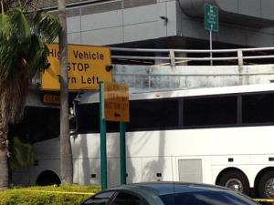 A bus is lodged into an overpass at the Miami International Airport on Saturday.