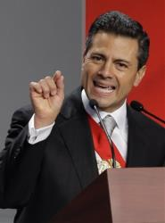 Mexico's newly sworn-in President Enrique Pena Nieto delivers his inaugural speech at the National Palace in Mexico City, Saturday, Dec. 1, 2012.