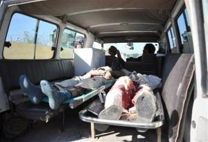 Bodies of Afghan civilians, killed during an attack by Taliban suicide bombers on a joint US-Afghan air base, in Jalalabad, Afghanistan, Sunday, Dec. 2, 2012.