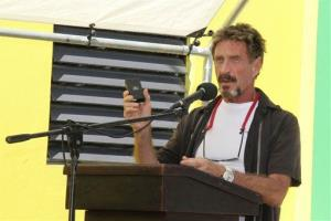 In this Thursday Nov. 8, 2012 file photo, John McAfee speaks at the official presentation of equipment ceremony that took place at the San Pedro Police Station in Ambergris Caye, Belize.