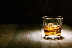 A New Zealand man says whiskey cured his blindness.