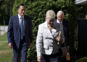 Mitt Romney, left, walks with JW Marriott Jr. towards the Church of Jesus Christ of Latter-day Saints  in Wolfeboro, NH earlier this year.