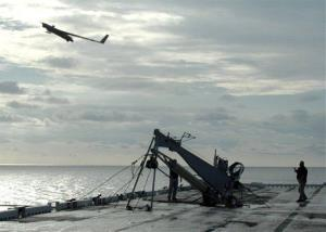 A Scan Eagle drone launches from the flight deck of the amphibious assault ship USS Saipan.