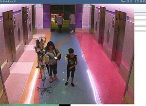 In this hospital surveillance photo, a woman is seen with her 11-year-old daughter. Authorities say the woman inexplicably took the girl from the hospital last week.