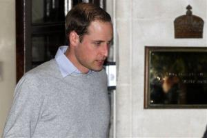 Britain's Prince William leaves the King Edward VII hospital where his wife Kate, the Duchess of Cambridge has been admitted with a severe form of morning sickness, central London, Dec. 3, 2012.