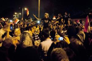 Egyptian protesters chant anti Muslim Brotherhood slogans during a demonstration in front of the presidential palace in Cairo, Egypt, Tuesday, Dec. 4, 2012.