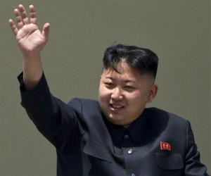 Kim Jong Un, leader of one of the most corrupt nations, waves from a balcony at the end of a mass military parade in Pyongyang's Kim Il Sung Square.