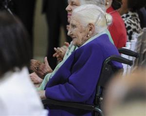 In a Oct. 26, 2011 file photo, Dame Elisabeth Murdoch sits in the audience as Queen Elizabeth II visits the Royal Children's Hospital in Melbourne.