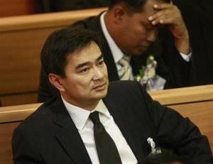 Former Thai Prime Minister Abhisit Vejjajiva, front, attends a meeting at parliament in Bangkok, Thailand Wednesday, Aug. 10, 2011.