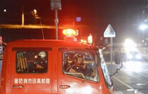 Firefighters call for residents to evacuate from coastal areas in Iwate Prefecture, Friday, Dec. 7, 2012, after a tsunami warning was issued.