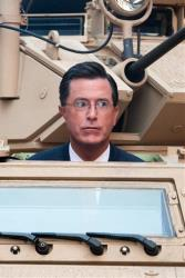 Stephen Colbert rides an Army ASV while taping an episode of the Colbert Report on West 54th Street in New York, Wednesday, September 8, 2010.