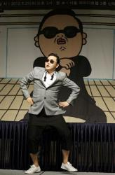 In this Sept. 25, 2012 photo, South Korean rapper PSY, who sings the popular Gangnam Style song, performs during a press conference in Seoul, South Korea.