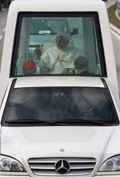 Pope Benedict XVI waves from his popemobile on his way to the airport during his departure from Havana, Cuba, Wednesday March 28, 2012.